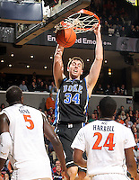 Feb. 16, 2011; Charlottesville, VA, USA; Duke Blue Devils forward Ryan Kelly (34) dunks over Virginia Cavaliers center Assane Sene (5) and Virginia Cavaliers guard K.T. Harrell (24) during the first half of the game at the John Paul Jones Arena.  Credit Image: © Andrew Shurtleff