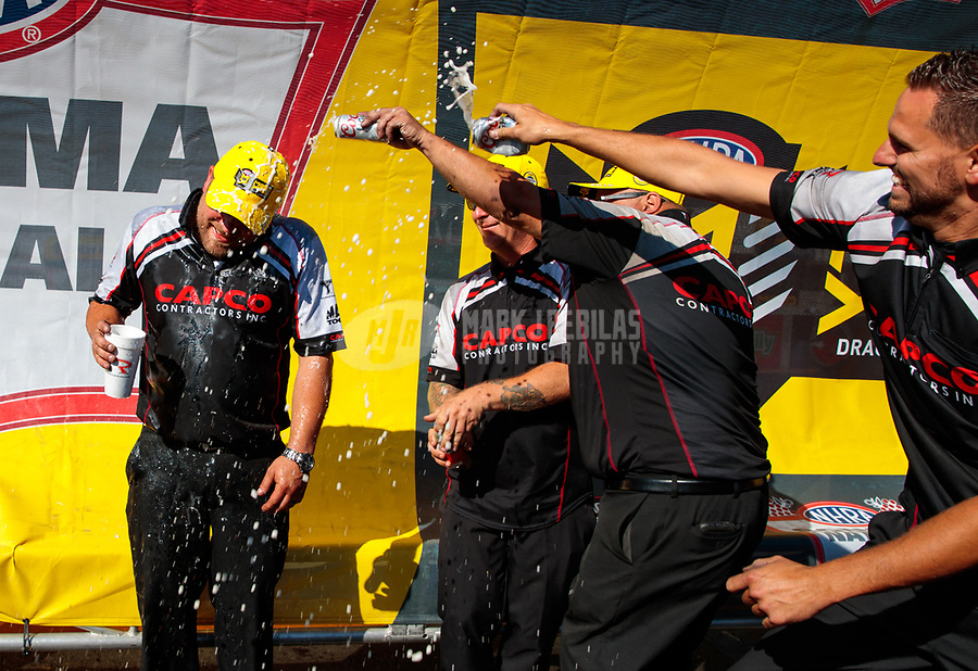 Jul 28, 2019; Sonoma, CA, USA; NHRA top fuel driver Billy Torrence celebrates with crew members after winning the Sonoma Nationals at Sonoma Raceway. Mandatory Credit: Mark J. Rebilas-USA TODAY Sports