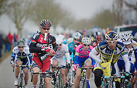 E3 Prijs Harelbeke.Thor Hushovd (NOR) emptying his musette
