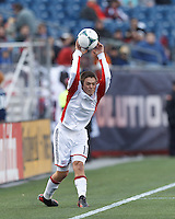 New England Revolution defender Kelyn Rowe (11) throw in.  In a Major League Soccer (MLS) match, Sporting Kansas City (blue) tied the New England Revolution (white), 0-0, at Gillette Stadium on March 23, 2013.