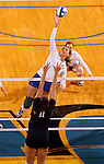 BROOKINGS, SD - NOVEMBER 14:  Wagner Larson #11 from South Dakota State University tips the ball over the defense of Sara Pope #11 from Oral Roberts University during their volleyball match Friday night at Frost Arena. (Photo by Dave Eggen/Inertia)