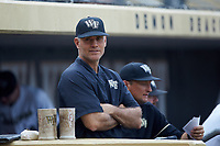 Wake Forest Demon Deacons head coach Tom Walter (16) watches from the dugout during the game against the Davidson Wildcats at David F. Couch Ballpark on May 7, 2019 in  Winston-Salem, North Carolina. The Demon Deacons defeated the Wildcats 11-8. (Brian Westerholt/Four Seam Images)