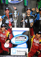Nov. 15, 2008; Homestead, FL, USA; NASCAR Nationwide Series driver Clint Bowyer (left) celebrates after winning the 2008 drivers championship as J.D. Gibbs celebrates after winning the 2008 owners championship following the Ford 300 at Homestead Miami Speedway. Mandatory Credit: Mark J. Rebilas-