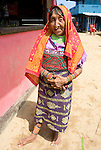 A Kuna woman in traditional clothing, Rio Sidra, San Blas Islands, Kuna Yala, Panama