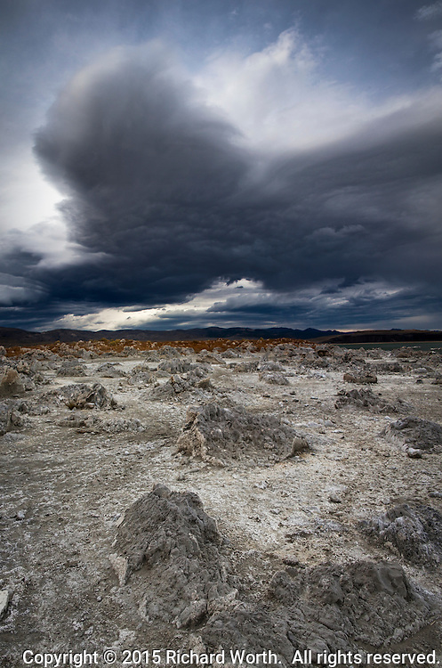 A near perfect culminatiion of earth, water and sky - geological  formations, tufa, on the shores of Mono Lake.  Overhead, an autumn sky full of foreboding clouds.