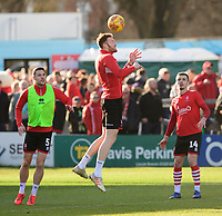 Lincoln City's Cian Bolger, centre, during the pre-match warm-up with team-mates Jason Shackell, left, and Harry Toffolo<br /> <br /> Photographer Chris Vaughan/CameraSport<br /> <br /> The EFL Sky Bet League Two - Lincoln City v Stevenage - Saturday 16th February 2019 - Sincil Bank - Lincoln<br /> <br /> World Copyright © 2019 CameraSport. All rights reserved. 43 Linden Ave. Countesthorpe. Leicester. England. LE8 5PG - Tel: +44 (0) 116 277 4147 - admin@camerasport.com - www.camerasport.com
