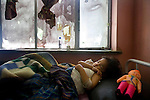 Shakofa, 2, recovers from burns to her chest and feet at Mirwais Hospital in Kandahar, Afghanistan, April 23, 2009. Shakofa was scalded by hot tea. Despite worsening security, development continues at Mirwais Hosptial, where the International Committe of the Red Cross conducts training and assists the local staff. Mirwais is the main public hosptial serving five southern provinces. As security has deteriorated in the South, many international NGO's have pulled their staff from the area or shut down the regional office, stunting development in a region where it is badly needed.
