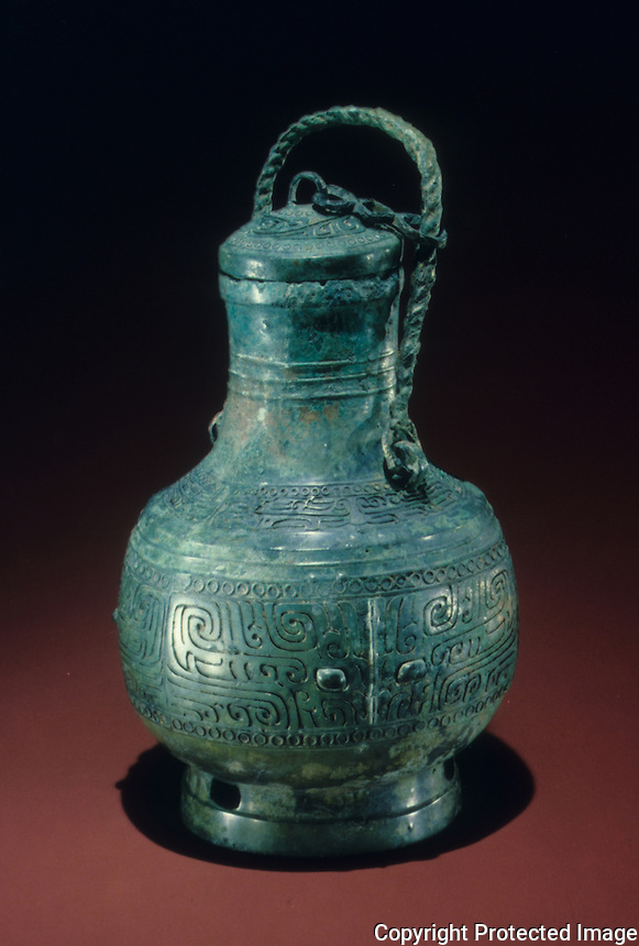 "China: Bronze wine vessel. Zhengzhou phase. 16th -14th C. B.C.  12 1/4"" high.   Hubel Provincial Museum.  Great Bronze Age of China."