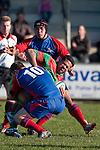 Manukia Manuika gets sandwiched in atackle between Dean Cummins & Gary Saifoloi. Counties Manukau Premier Club Rugby game between Waiuku & Ardmore Marist played at Waiuku on Saturday 20th June, 2009. Waiuku won the game 28 - 25.