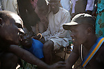 18 december 2010 - Juba, Southern Sudan - Members of the Dinka tribe from Bor, Jonglei State talk before the final of South Sudan's first commercial wrestling league between their tribe and the Mundari wrestlers from Central Equatoria State at Juba Stadium. The matches attracted large numbers of spectators who sang, played drums and danced in support of their favorite wrestlers. The match organizers hoped that the traditional sport would bring together South Sudan's many different tribes. Photo credit: Benedicte Desrus