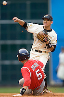 Missouri TIger Eric Garcia turns a double play against the Houston Cougars on Friday March 5th, 2100 at the Astros College Classic in Houston's Minute Maid Park.  (Photo by Andrew Woolley / Four Seam Images)