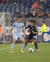 Sporting Kansas City midfielder Milos Stojcev (88) attempts to control the ball as New England Revolution defender Kevin Alston (30) pressures. In a Major League Soccer (MLS) match, the New England Revolution defeated Sporting Kansas City, 3-2, at Gillette Stadium on April 23, 2011.