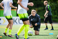 Seattle, WA - Sunday, May 22, 2016: Seattle Reign FC head coach Laura Harvey helps during warm-ups, prior to a regular season National Women's Soccer League (NWSL) match at Memorial Stadium.