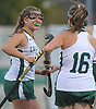 Alexandra Nagy #8 of Carle Place, left, congratulates Emiline Biggin #16 after she scored a goal late in the first half of the Nassau County varsity field hockey Class C final against Oyster Bay at Adelphi University on Saturday, Oct. 28, 2017. Biggin and teammate Julia Pascarella (not in picture) scored two goals each in Carle Place's 5-0 win.