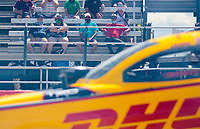 Jul 12, 2020; Clermont, Indiana, USA; NHRA fans in the crowd wear face masks as they watch funny car driver J.R. Todd during the E3 Spark Plugs Nationals at Lucas Oil Raceway. This is the first race back for NHRA since the start of the COVID-19 global pandemic. Mandatory Credit: Mark J. Rebilas-USA TODAY Sports