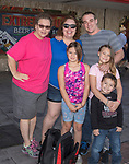 The Reyes family during the Hot August Nights Parade in downtown Reno on Sunday, August 13, 2017.