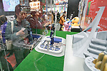 A visitor looks at an action figure of Mazinger Z on display during the AnimeJapan 2017 at Tokyo Big Sight on March 25, 2017, Tokyo, Japan. AnimeJapan 2017 is a trade show promoting ''Everything Anime'' to local and foreign fans and businesses. The show is held over four-day days with March 23-24 reserved for business visitors and March 25-26 for the public. It is expected to attract some 120,000 visitors, including cosplayers. (Photo by Rodrigo Reyes Marin/AFLO)