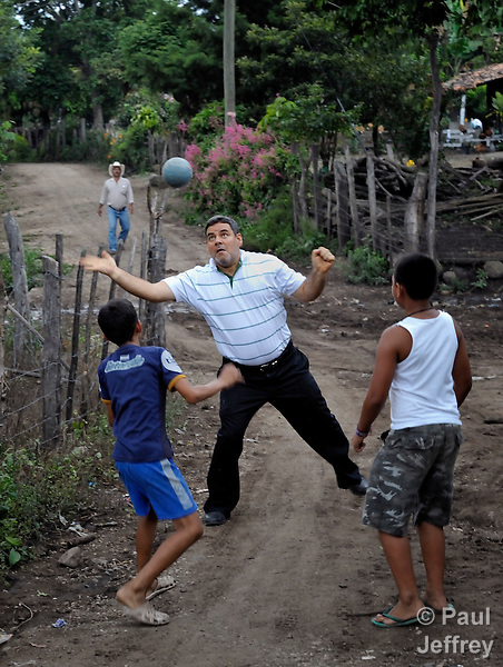 The Rev. Juan Guerrero, a native of Colombia, is a United Methodist missionary and superintendent of the church's mission in Honduras. Here he plays soccer with some children in the rural village of Quisgualagua.