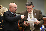Nevada Assembly Republicans Ira Hansen, left, and P.K. O'Neill work on the Assembly floor at the Legislative Building in Carson City, Nev., on Friday, April 3, 2015. <br /> Photo by Cathleen Allison