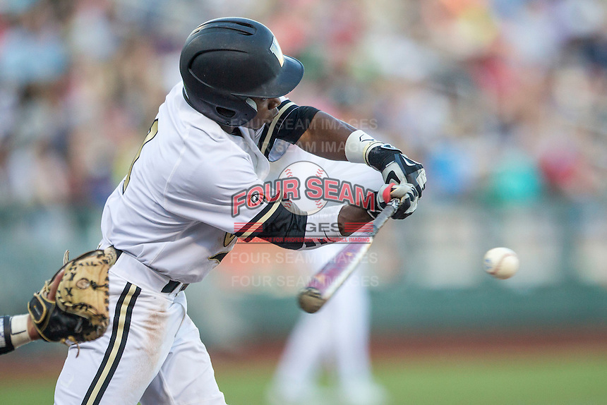 Vanderbilt Commodores designated hitter Ro Coleman (1) swings the bat against the TCU Horned Frogs in Game 12 of the NCAA College World Series on June 19, 2015 at TD Ameritrade Park in Omaha, Nebraska. The Commodores defeated TCU 7-1. (Andrew Woolley/Four Seam Images)