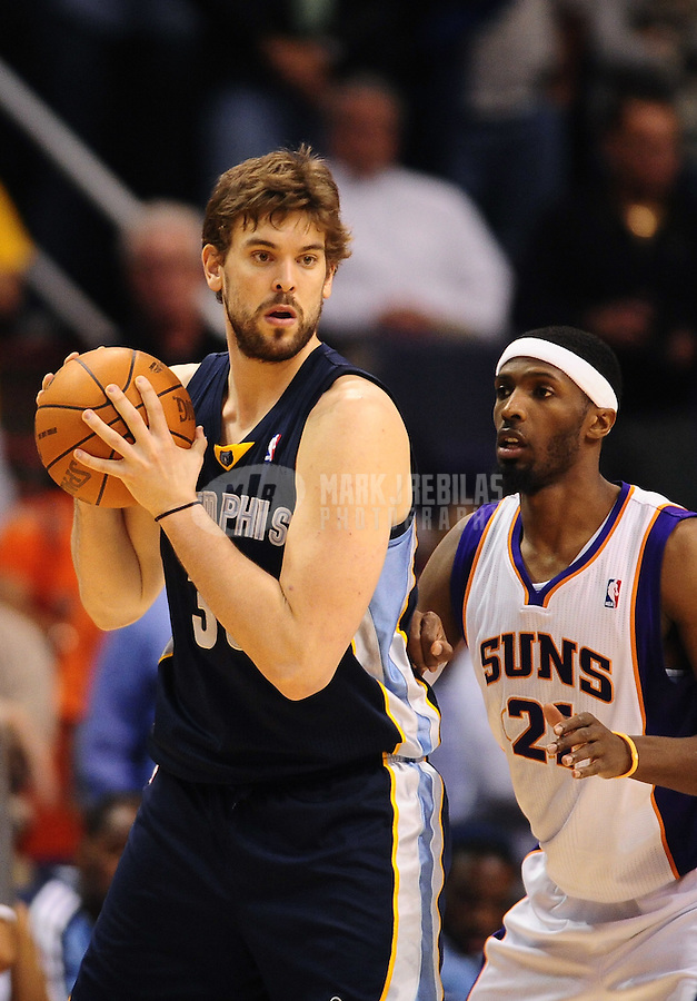 Dec. 8, 2010; Phoenix, AZ, USA; Memphis Grizzlies center (33) Marc Gasol is defended by Phoenix Suns forward Hakim Warrick at the US Airways Center. Memphis defeated Phoenix 104-98 in overtime. Mandatory Credit: Mark J. Rebilas-