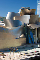 Architect Frank Gehry's Guggenheim Museum futuristic architectural design in titanium and glass, giant spider sculpture 'Maman' in Bilbao, Spain
