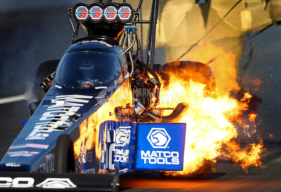 Nov 10, 2013; Pomona, CA, USA; NHRA top fuel dragster driver Antron Brown blows an engine in flames during the Auto Club Finals at Auto Club Raceway at Pomona. Mandatory Credit: Mark J. Rebilas-