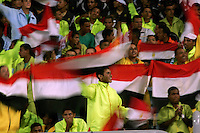Fans wave Egyptian flags at the opening of the FIFA Under 20 World Cup Group A Match between Trinidad & Tobago at the Egyptian Army Stadium on September 24, 2009 in Alexandria, Egypt.The opening game was attended by 74,000 fans according to FIFA. Many sections of the stadium was filled with uniform looking young men in matching workout clothes. .