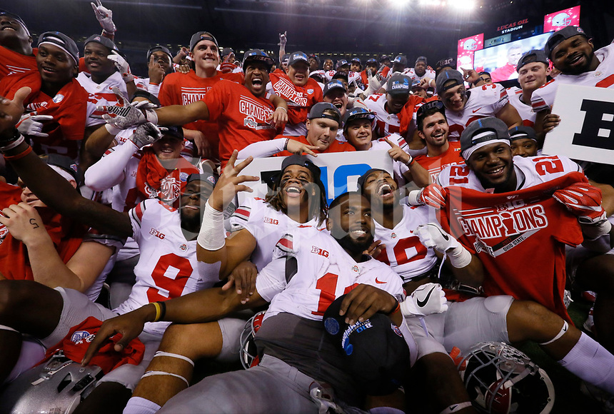 Ohio State Buckeyes quarterback J.T. Barrett (16) was front and center as the Buckeyes celebrated a 27-21 win over the Wisconsin Badgers in the Big Ten Championship game at Lucas Oil Stadium in Indianapolis on Sunday, December 3, 2017. [Barbara J. Perenic/Dispatch]