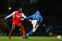 Andrew Cannon of Rochdale gets away from Toumani Diagouraga of Fleetwood Town during the Sky Bet League 1 match between Rochdale and Fleetwood Town at Spotland Stadium, Rochdale, England on 20 March 2018. Photo by Thomas Gadd.