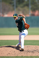 Oakland Athletics relief pitcher Calvin Coker (41) delivers a pitch during an Instructional League game against the Chicago White Sox at Lew Wolff Training Complex on October 5, 2018 in Mesa, Arizona. (Zachary Lucy/Four Seam Images)