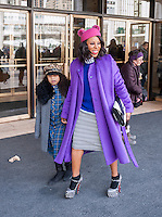 Fashionistas in their finery outside of the Fall 2014 Fashion Week shows in Lincoln Center in New York on Saturday, February 8, 2014. This year some designers are abandoning the tents at Lincoln Center to hold their shows at far flung venues, including Brooklyn.  (© Richard B. Levine)