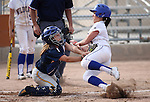 Western Nevada's Andrea Lee collides with College of Southern Nevada's catcher during a college softball game in Carson City, Nev., on Thursday, March 14, 2013..Photo by Cathleen Allison