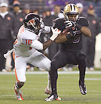 Washington Huskies running back Bishop Stankey ,right,  covers the ball as he gets hit by Oregon State Beavers Rashaad Reynolds (16) at CenturyLink Field in Seattle, Washington on October 27, 2012.   Stankey rushed for 98 yards  on 25 carries and scored two touchdowns in  the Huskies  20-17 upset win over the 7th ranked Beavers.   ©2012. Jim Bryant Photo. ALL RIGHTS RESERVED.