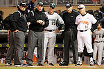 Maryland head coach John Szefc (14) and Michigan State head coach Jake Boss (23) meet with the umpires before a Big 10 tournament baseball game in Minneapolis, Wednesday, May 20, 2015. Maryland defeated Michigan State 2-1. ( Photo/Ann Heisenfelt)