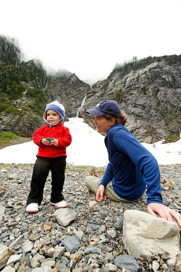 Young girl and her mother in mountainous boulder field, Big Four Trail, Mt Baker Snoqualmie National Forest, Washington, USA