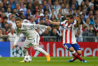 Real Madrid's Spanish defense Sergio Ramos and Atletico Madrid´s Spanish midfielder Koke