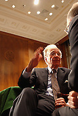 """News Corporation Chairman and CEO Rupert Murdoch has an animated discussion with one of the other witnesses before the United States Senate Committee on the Judiciary Subcommittee on Antitrust, Competition, and Business and Consumer Rights hearing on """"The NewsCorp/Direct TV Deal: The Marriage of Content and Global Distribution"""" in Washington, DC on June 18, 2003.."""