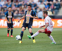 Sebastien Le Toux (11) of the Philadelphia Union passes the ball away from Michael Bustamente (23) of the New York Red Bulls during a Major League Soccer game at PPL Park in Chester, PA.  Philadelphia defeated New York, 3-0.