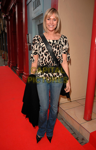 JENNI FALCONER.At the Andrex Puppy Red Nose Day Charity Lunch and Auction, The Clerkenwell, London, England, .February 26th 2007..full length black waist belt leopard print top jeans.CAP/CAN.©Can Nguyen/Capital Pictures