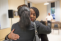 Ayanna Pressley (right) greets people after speaking at an event put on by Chelsea Black Community at the Chelsea Senior Center in Chelsea, Massachusetts, USA, on Wed., June 27, 2018. Pressley is running in the Democratic primary Massachusetts 7th Congressional District against incumbent Mike Capuano. Pressley is currently serving as a member of the Boston City Council, and is the first woman of color elected to the Council.
