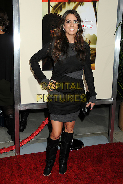 "Haroula Rose.""The Descendants"" Los Angeles Premiere held at the AMPAS Samuel Goldwyn Theater, Beverly Hills, California, USA, 15th November 2011..full length black dress hand on hip knee high boots  grey gray striped clutch bag .CAP/ADM/BP.©Byron Purvis/AdMedia/Capital Pictures."
