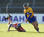 John Looney of Cork  in action against David Reidy of Clare during their Munster Hurling League game at Cusack Park. Photograph by John Kelly.