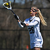 Allison Stackpole #28 of Adelphi University makes a pass during an NCAA Division II women's lacrosse game against Merrimack College at Motamed Field in Garden City, NY on Saturday, April 8, 2017. Top-ranked Adelphi won by a score of 19-1.