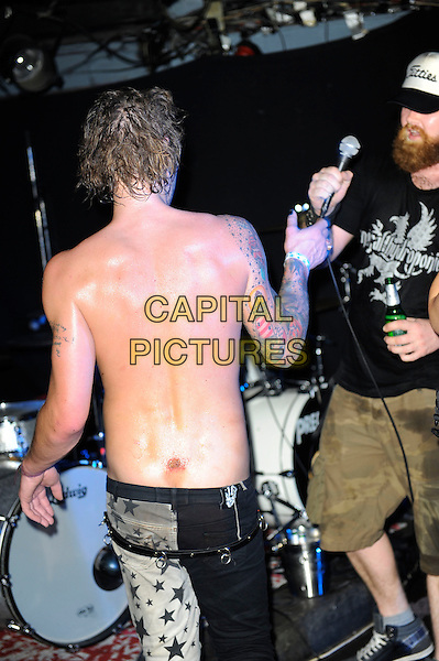 Fuckface Unstoppable performing in concert, Camden Underworld, London, England. <br /> 23rd July 2013<br /> *special rates apply*<br /> on stage in concert live gig performance performing music half length topless back behind rear injury wound sore scab tattoos black white stars print trousers <br /> CAP/MAR<br /> &copy; Martin Harris/Capital Pictures