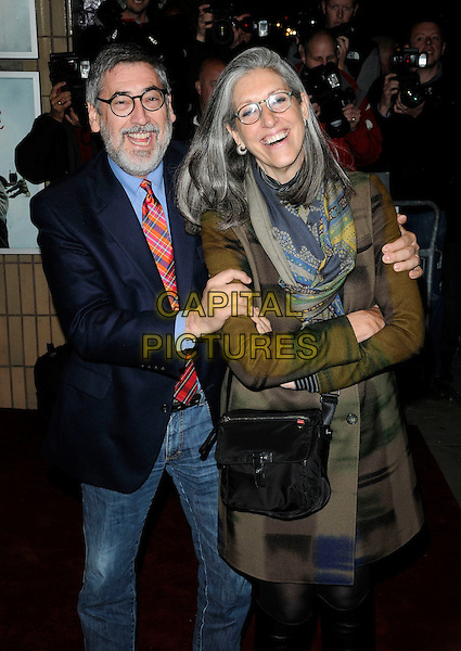 JOHN LANDIS & wife DEBRA LANDIS.Attends the 'Burke and Hare' World Premiere at The Chelsea Cinema, Kings Road, Chelsea, London, England, UK, 25th October 2010..half length jeans blazer  glasses red tartan plaid tie black navy blue jacket shirt poppy beard facial hair green print scarf couple coat .CAP/CAN.©Can Nguyen/Capital Pictures.