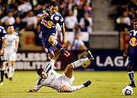 Rafael Marquez of the New York Red Bulls leaps over LA Galaxy forward Jovan Kirosvki. The New York Red Bulls beat the LA Galaxy 2-0 at Home Depot Center stadium in Carson, California on Friday September 24, 2010.
