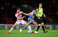 Doncaster Rovers' Ben Whiteman vies for possession with Lincoln City's Jorge Grant<br /> <br /> Photographer Chris Vaughan/CameraSport<br /> <br /> EFL Leasing.com Trophy - Northern Section - Group H - Doncaster Rovers v Lincoln City - Tuesday 3rd September 2019 - Keepmoat Stadium - Doncaster<br />  <br /> World Copyright © 2018 CameraSport. All rights reserved. 43 Linden Ave. Countesthorpe. Leicester. England. LE8 5PG - Tel: +44 (0) 116 277 4147 - admin@camerasport.com - www.camerasport.com