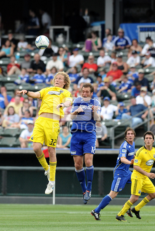 Jimmy Conrad (blue), Steven Lenhart...Kansas City Wizards were defeated 1-0 by Columbus Crew at Community America Ballpark, Kansas City, Kansas.