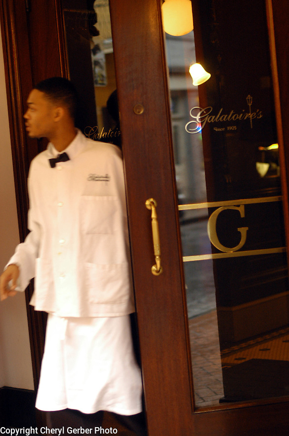 A food runner looks out the door on Bourbon Street during lunch at Galatoire's in New Orleans, Friday, January 28, 2005..(CHERYL GERBER PHOTO).